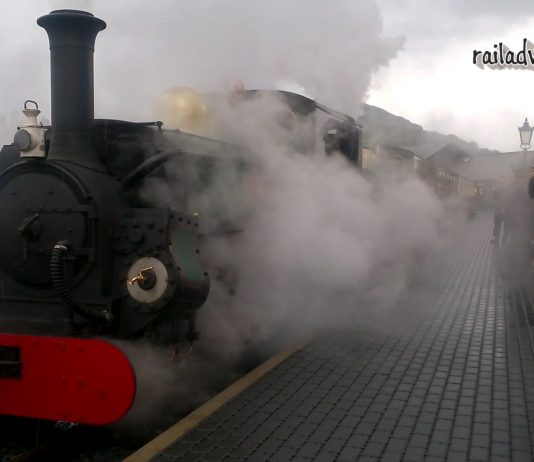 Linda and Blanche emerge through the steam departing Porthmadog