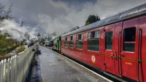 Haulwen and its train at Bronwydd Arms on the Gwili Railway