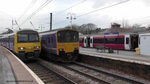 Arriva Rail North 150142 passes 322485 at Skipton