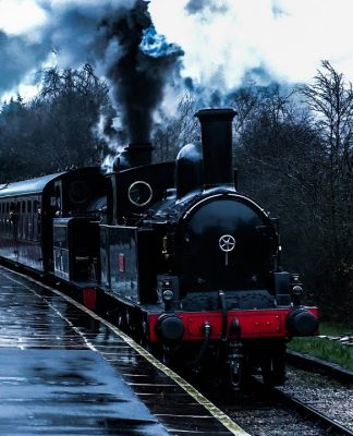 No. 1054 and 85 steam through Oakworth at the Winter Steam Gala at the Keighley & Worth Valley Railway