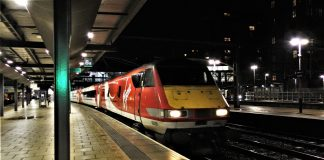 A Virgin Trains East Coast Class 91 / 225 departs Leeds with a service to Kings Cross