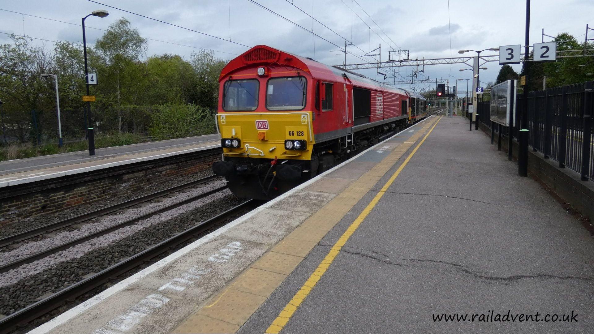DB Cargo UK Class 66 No. 66128 leads 074L through Hemel Hempstead