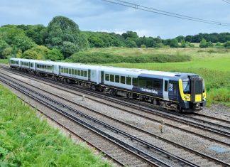 444040 working 3Z01 London Waterloo - Northam passes through Potbridge.