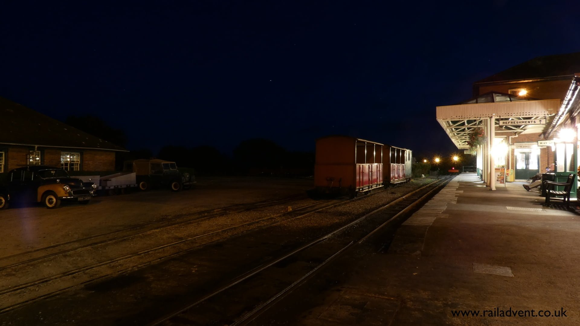 Talyllyn Open Carriages stand in the middle road during Talyllyn Steam at Night event