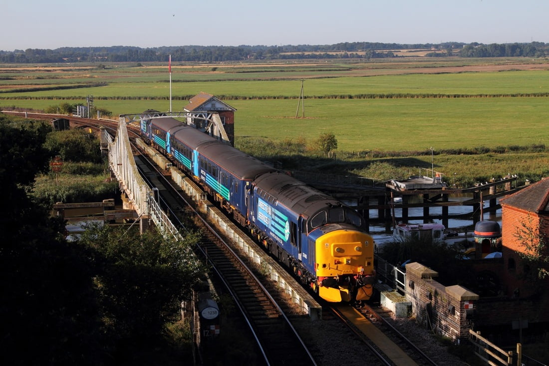Two Class 37 diesels top and tail a service train over the Reedham Swing Bridge in 2016