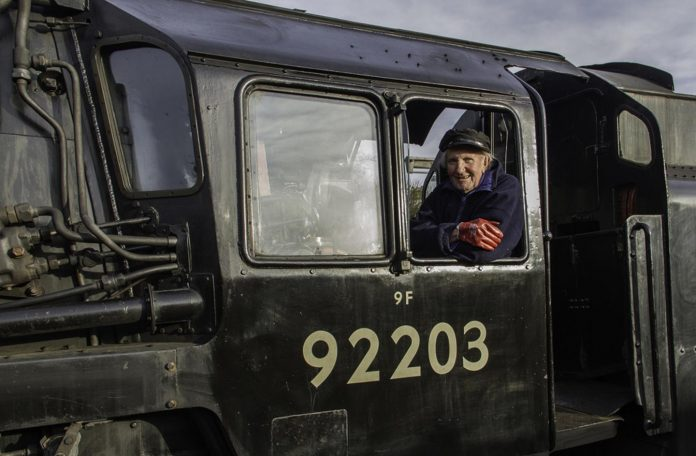 David Shepherd on the Footplate of 92203