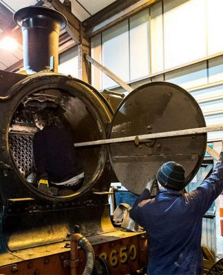 Removing Boiler Tubes from 3650 // Credit Didcot Railway Centre