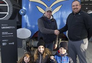Sean and his Family with Museum Manger Gary Campbell // Credit NRM