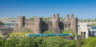 Conwy castle with an Arriva Trains Wales service for Holyhead