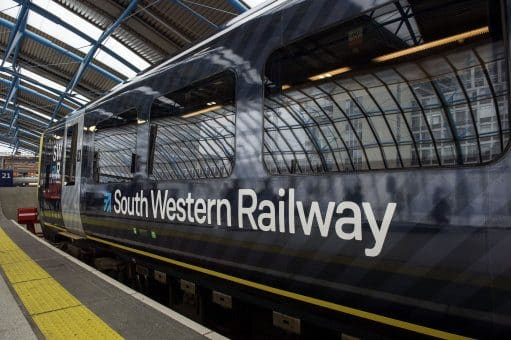 South Western Railway's first fully-liveried Class 444 train arrives into the former international terminal at Waterloo station in central London as the train operating company launches its new brand.