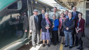 Friends of Elizabeth Ralph stand next to GWR train named after her