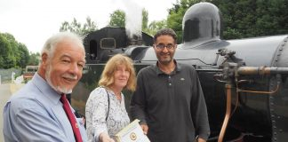 John Snell, Chairman of WyvernRail plc, presenting a certification of donation to Janet Fuller and Ahmed, both of Derby Refugee Advice Centre at Duffield station