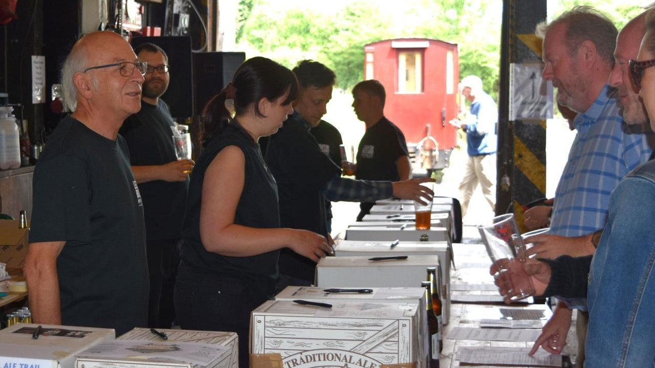 thirsty customers are served by volunteers in the Engine Shed Bar