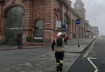 A firefighter close to Nottingham railway station which has been evacuated and services passing through cancelled after a fire broke out. PRESS ASSOCIATION Photo. Picture date: Friday January 12, 2018. Nottinghamshire Fire and Rescue service say that eight appliances are in attendance at a major incident. See PA story FIRE Station. Photo credit should read: Matthew Vincent/PA Wire