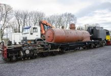 The new boiler for NG/G16 130 arrives at Dinas by road and is lifted on to the frames of the locomotive.