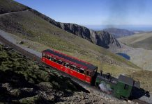 SMR No 3 'Enid' takes the 09.30 'Mountain Goat' Heritage Steam service up to the summit on a rare clear-as-a-bell day in North Wales. Saturday 14th May 2016