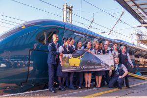 Staff stand next to Class 390 Pendolino at Preston