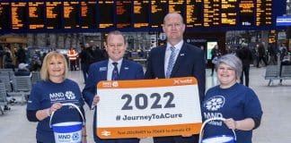 GLASGOW, SCOTLAND - FEBRUARY 05: ScotRail joins up with MND Scotland as part of the 2022 Journey to Care in Glasgow Central Station on February 05, 2020. Pictured: Alex Hynes, (Managing Director of Scotland's Railway) and Iain McWhirter (Head of Fundraising MND Scotland) alongside members of Staff from MND Scotland and Scotrail Alliance. (Photo by Bill Murray / SNS Group)