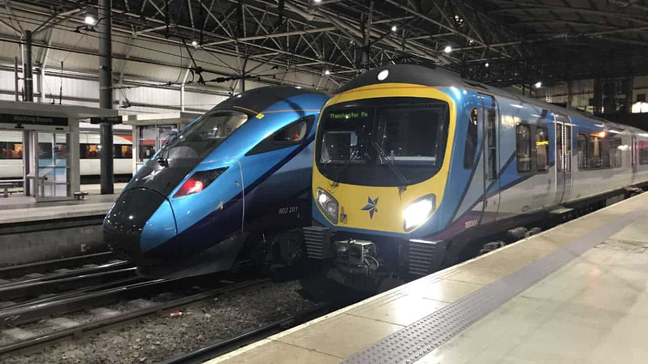 Transpennine Express trains pass at Leeds