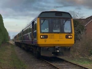 Class 142060 and 142028 arrive at the Wensleydale Railway