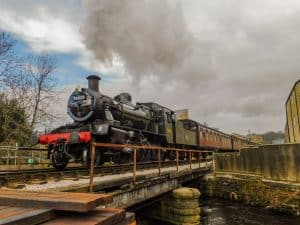 78022 heads the last train service over the old Bridge 11 on the Keighley and Worth Valley Railway