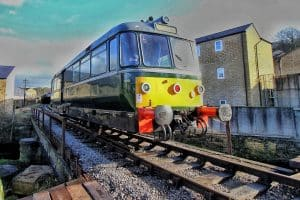 Diesel railbus passes over Bridge 11 on the Keighley and Worth Valley Railway