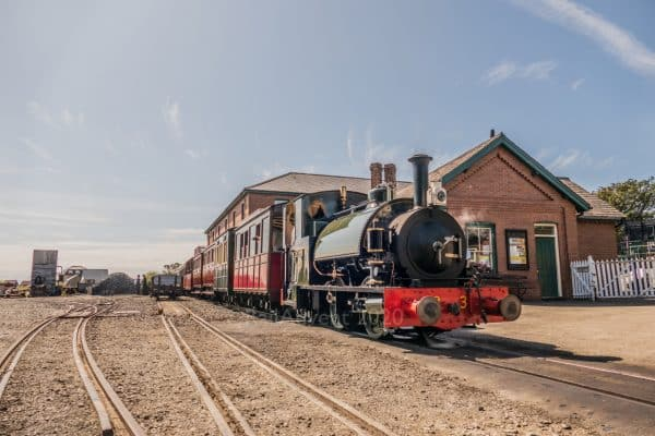 Sir Haydn stands at Tywyn Wharf on the Talyllyn Railway