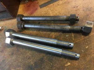 Old and New Valve Guide Bolts // Credit Darrin Crone