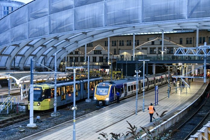 Manchester Victoria station with Northern 195 and Metrolink