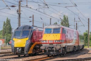 Grand Central Class 180 passes LNER 225 at York