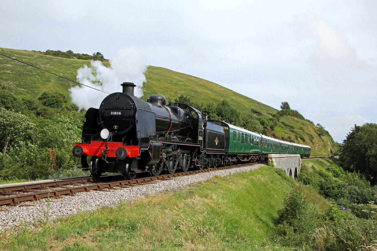 31806 near Corfe Castle on the Swanage Railway