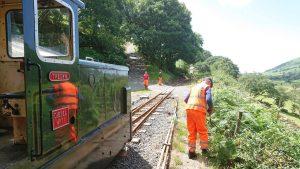 Talyllyn Railway staff strimming the trackside