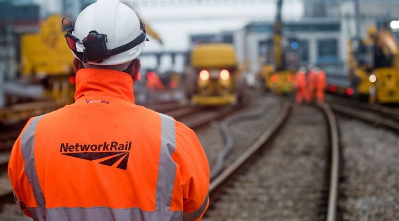Network Rail Worker On Track