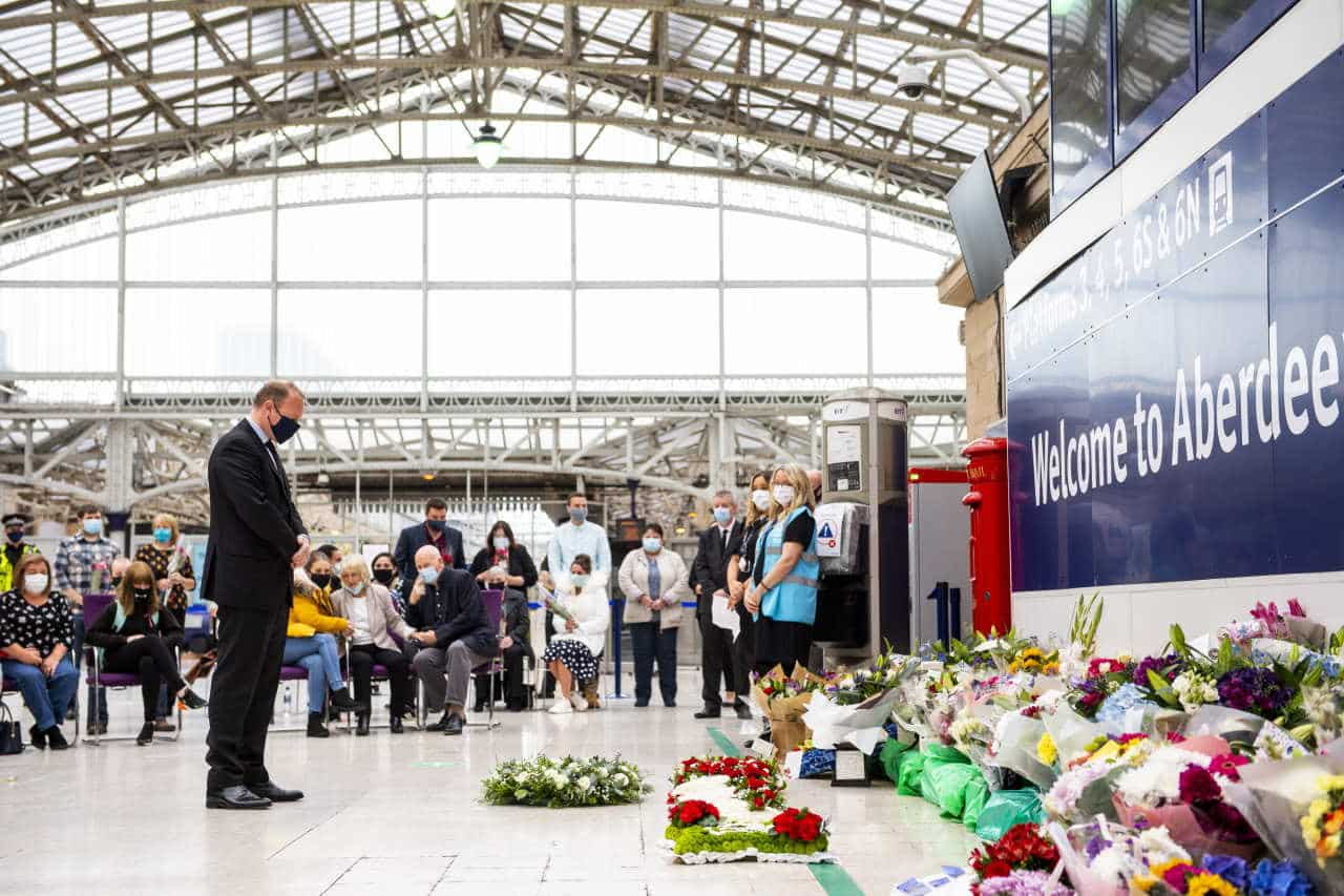 Alex Hynes, Managing Director, Scotland's Railway lays at wreath at Aberdeen station as the railway remembers those who lost their lives in the Stonehaven derailment