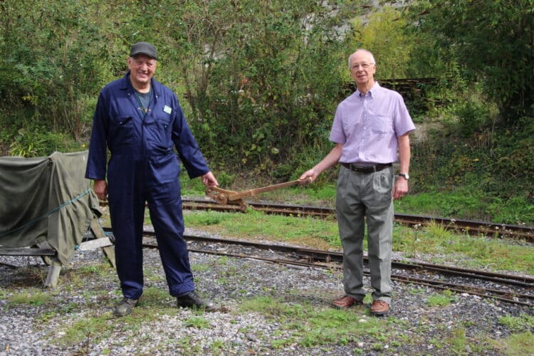 John Stanton, joint head of the Museum's railway volunteer group, accepts the missing expansion link from Peter Heather