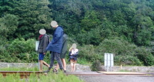 A group walk along the railway track at Harlech