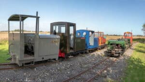 """A panoramic view of the cavalcade assembled at South Loop (l-r) Wilton, Major J A Robins RE, Paul, T3, and on the front track: Nocton, 8622, the """"Skeg Simplex"""" and Sark."""