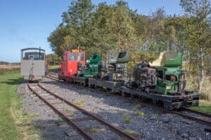 """The three 'original' Simplexes – those not fitted with bodywork by owners – have their bonnets up waiting to be started, while coupled to Sark: (l-r) the """"Skeg Simplex"""", 8622 and Nocton."""