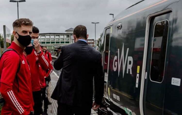 Joe Rodon, Kieffer Moore and other members of the Wales team about to board