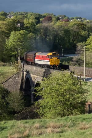 31163 leaves Oakworth on the Keighley and Worth Valley Railway