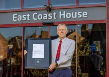 Paul Taylor with his letter and challenge coin outside the LNER HQ