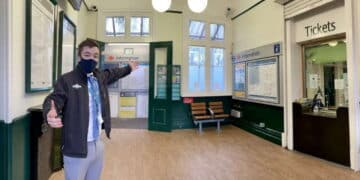 Station Manager Nathaniel Owen invites passengers to North Dulwich station's Twenties-style transformation