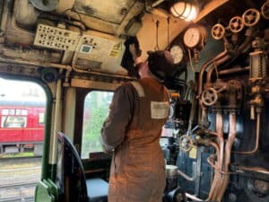 Cleaning the cab of 60163 Tornado