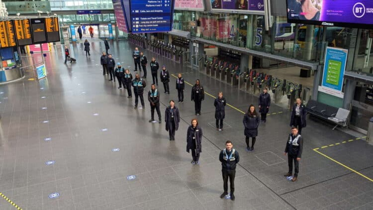 Train crew and station staff on the social distancing guides at Manchester Piccadilly
