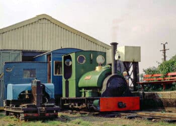 "LCLR's 1903-vintage steam loco, ""Jurassic"" (an 0-6-0ST built by Peckett and Sons Ltd of Bristol, works number 1008, for Kaye & Co's cement works, later Rugby Portland Cement Co., at Southam in Warwickshire), stands at the second North Sea Lane HQ alongside 1920-vintage Simplex bow-frame 4wDM 'Nocton' (Motor Rail Ltd builder's number 1935), ready for the day's duties in August 1971"