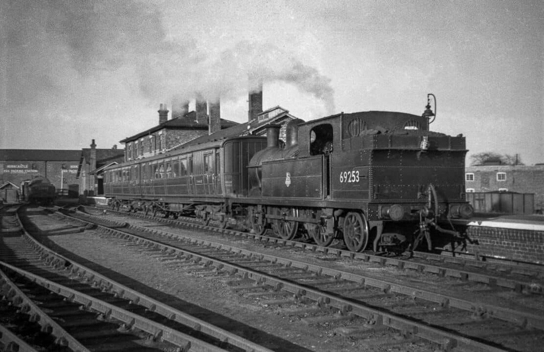 an everyday sight missing after the 1954 closure to passenger trains – N5 Class steam engine No. 69253 is ready to depart Horncastle for Woodhall Spa and Woodhall Junction, with the regular equally elderly carriages allocated to the branch