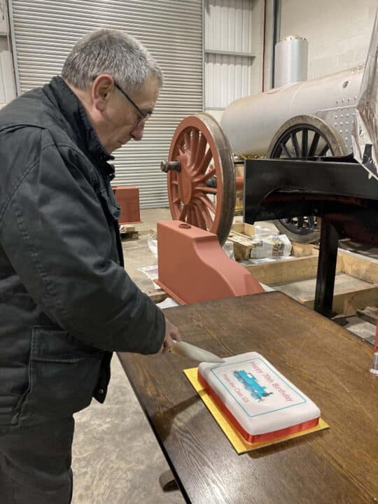 G5 Project Engineer cutting his 70th birthday cake