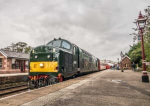 Class 37 D6851 stands at Appleby with The Staycation Express
