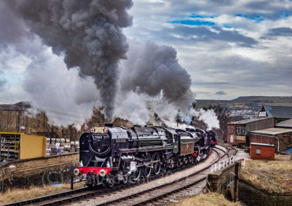 70013 Oliver Cromwell & 53808 steam out of Keighley