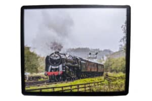 This plastic wipe-clean mouse mat features the 9F steam locomotive 92134 approaching Levisham on the North Yorkshire Moors Railway